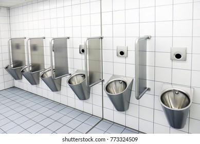 automatic urinals in a modern toilet