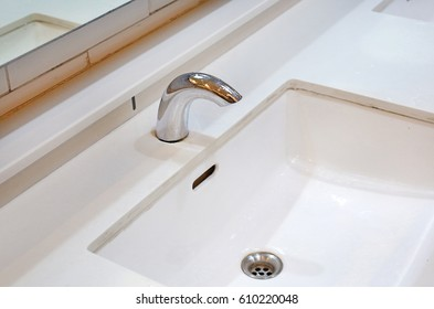 Automatic water tap and white ceramic sink