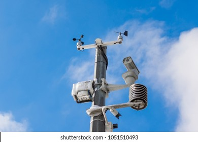 Automatic weather station, with a weather monitoring system and video cameras for observation. Against the background of a blue sky with clouds.