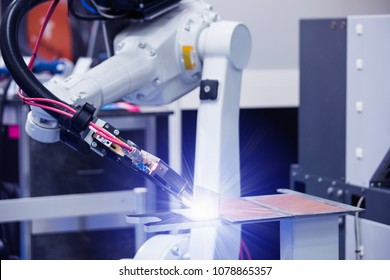 Automatic welding robot in a modern factory in operation. Assembly line