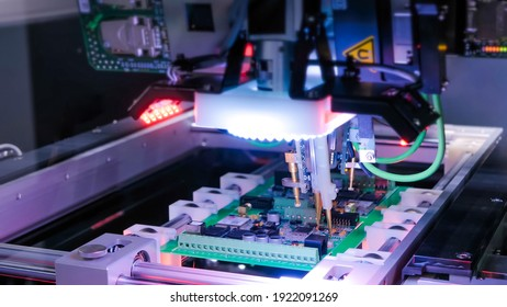 Automation machine equipment for quality testing of printed circuit boards - flying probe test at factory. Automated technology, industrial, robotic, electronic, production, manufacturing concept