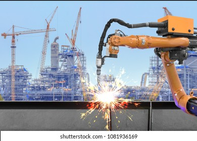Automation robot welder welding i beam steel structure construction by metal arc welding against industrial factory site in sunset