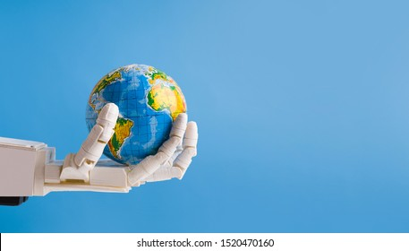 Automatization and artificial intelligence in world. Robot holding Earth globe in hand, blue panorama background with empty space