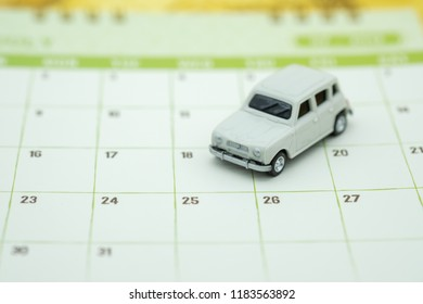 Automobil, Planning, Finance and Schedule concept. Close up of miniature white car toy on calendar.