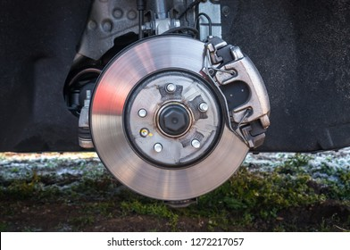 Automobile braking system and brake disk with support - car without wheel