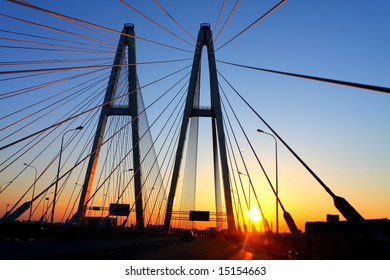 Automobile Bridge in St. Petersburg at sunset, Neva river. Russia.