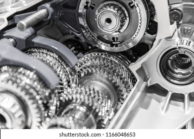 Automobile car gearbox with toothed wheels. Inside view on gearbox cross section with gears and shafts. Car gearbox with open hood cover.