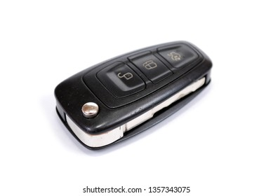 The automobile ignition key with the built-in electronic brelok of blockage of doors on white background. It is isolated.