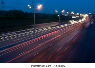 automobile lights at night on the highway
