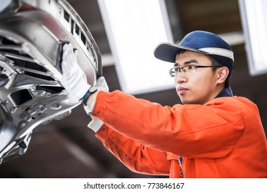 Automobile manufacturing, engineers are carefully checking the body frame