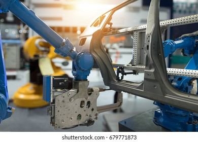 Automobile manufacturing production industrial machine , factory robot arm in smart factory and industry 4.0 concept. Flare light effect.