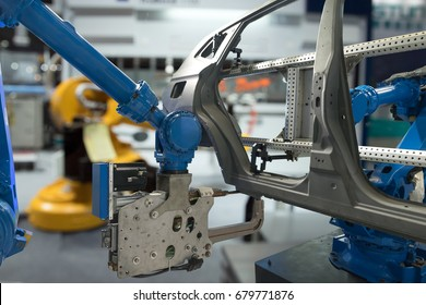 Automobile manufacturing production industrial machine , factory robot arm in smart factory and industry 4.0 concept.