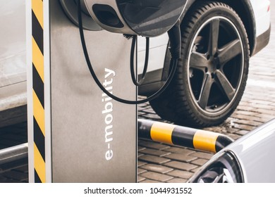 Automobile refueling for electric cars e-mobility in the background car, wheel.