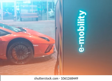 Automobile refueling for electric cars e-mobility in the background super car, wheel