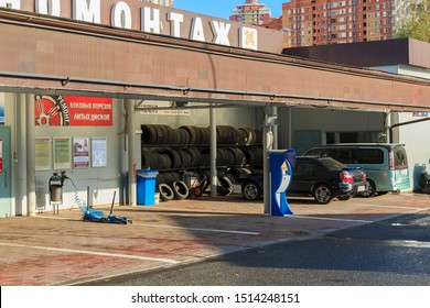 automobile repair shop (garage or  workshop) is establishment where automobiles are repaired by auto mechanics and technicians. street tire service in Krasnogorsk Moscow region Russia September 2019.