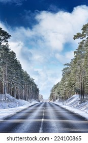 Automobile road in winter forest
