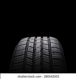 automobile rubber tires isolated on black background