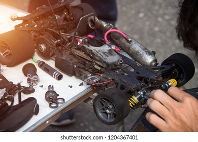 Automobile sport, the participant prepares his car with an internal combustion engine for racing competitions, nitro, close-up