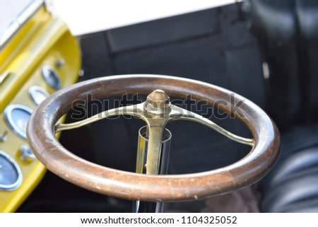 Automobile: Steering wheel of antique roadster.