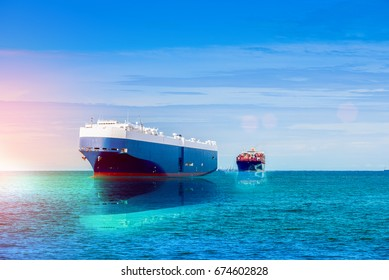 Automobile Transporter underway at sea, logistics and transportation of international, ship in ocean at twilight sky, sun set, freight Transportation, shipping