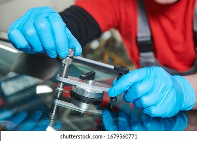 automobile windshield glass repair service. Car glass or chip crack repairing