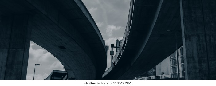 automotive bridges in an urban environment on a sky background. Horizontal banner.