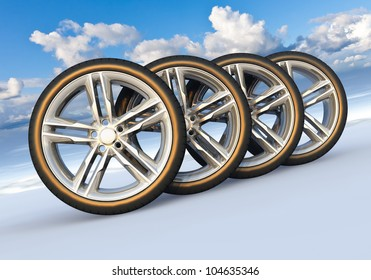 Automotive concept: set of car wheels in scenic snowy landscape