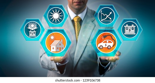 Automotive designer presenting electric vehicle efficiently charged by rooftop solar photovoltaic electricity generation. Renewables industry concept for advancements in battery storage technology.