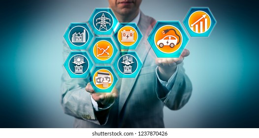 Automotive executive forecasting market growth for electric vehicles running on renewable energy sources following declining cost of electricity storage technologies. Concept for sustainability.