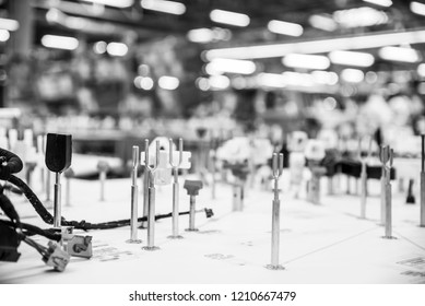 Automotive industry, manufacturing wiring harnesses. Monochrome industrial background with copyspace