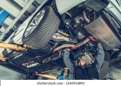 Automotive Mechanic Job. Caucasian Auto Service Worker and the Vehicle Maintenance.