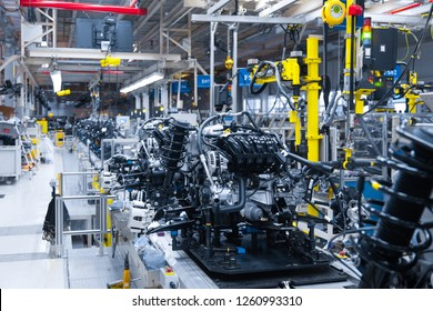 Automotive mechanical assembly, engine, transmission, suspension and breaking system. Automotive engine assembly line is in production. Car Assembly by parts