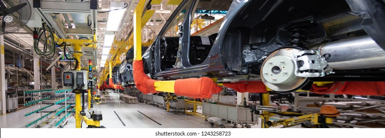 Automotive production line. Long format. Wide angle view of plant of automotive industry. Can be used as a banner