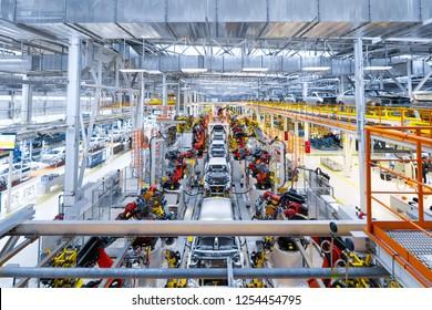 Automotive production line. Welding car body. Modern car Assembly plant