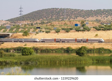 Automotive train of travelers, with diesel traction used as regional transport in Spain as it passes through Mérida with the Guadiana River in the foreground