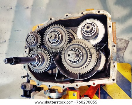 Automotive transmission gearbox with metal gearwheels and bearings inside.