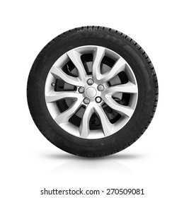 Automotive wheel on gray light alloy disc isolated on white background with soft shadow