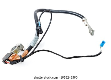 Automotive wiring harness with negative battery terminal and squib for disconnection in case of an accident. Vehicle security systems.