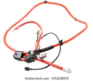 Automotive wiring harness with positive battery terminal and squib for disconnection in case of an accident. Vehicle security systems.
