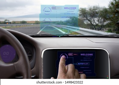 autonomous car with autopilot in hologram and blue and purple touch screen