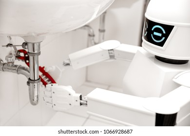 Autonomous service robot is fixing something in the bathroom, with an pipe wrench under the sink