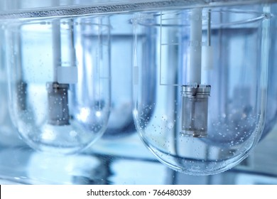 Autonomous solubility tester. Imitation dissolution of the tablet in the human stomach. Scientific research of pharmaceutical laboratory. Man conducts scientific work at the plant. Laboratory research