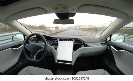 AUTONOMOUS TESLA CAR, FEBRUARY 2016:  Absolutely autonomous self-driving autopilot Tesla Model S driverless car with next gen ultrasonic sensors, cameras and radars driving along the turnpike highway