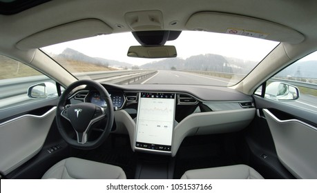 AUTONOMOUS TESLA CAR, FEBRUARY 2016: Passenger in the backseat of absolutely autonomous next gen self-driving Tesla car. A driverless car with upgraded avtopilot feature driving on countryside road