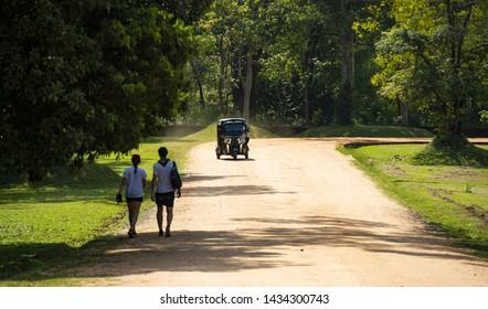 An auto-rickshaw (also called tuc tuc or tuk tuk) is heading towards the Lion Rock in Sigiriya. Lion Rock in Sigiriya is one of the most popular monuments in Sri Lanka.
