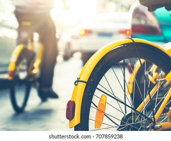 Autos and bicycles on road together in Tianjin city,China.Now people are more willing to choose riding shared bikes than driving,riding is more convinient and environmentally friendly.