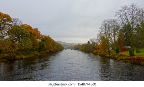 Autum trees on each side of a river bank