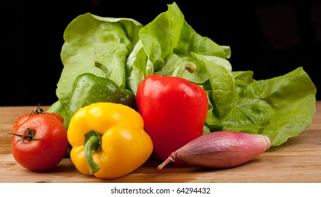 autum vegetables,on a wooden board,black background