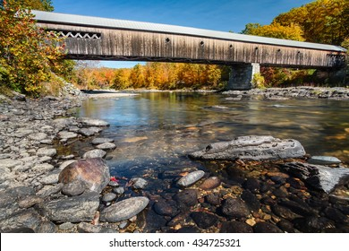Autumm color at the West Dummerston Covered Bridge over the West River in Dummerston, Vermont.