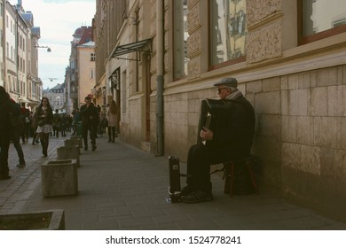 Autumn 2019. old man playing the accordion. on street